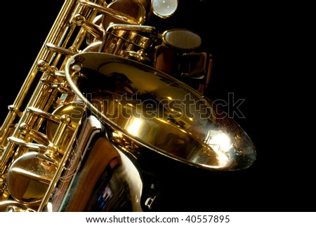 Alto saxophone with little dust for backgound - stock photo