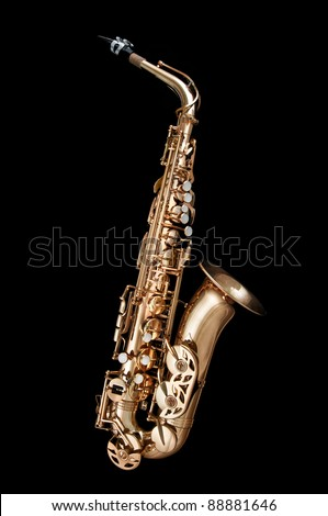 Alto Saxophone woodwind instrument isolated over black background - stock photo