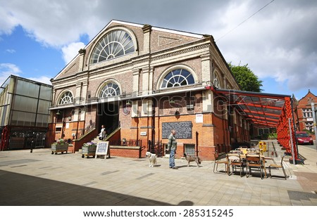 ALTRINCHAM, UK - JUNE 7 2015: Altrincham market. Altrincham is a market town in Trafford, Greater Manchester and an affluent commuter town with a a strong middle class presence - stock photo