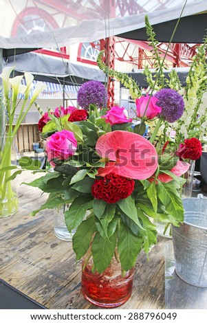 ALTRINCHAM, UK - JUNE 7 2015: Flowers on a stall at Altrincham market, Manchester. Altrincham is a market town in Trafford, Greater Manchester and an affluent commuter town  - stock photo