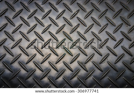 Aluminium dark list with rhombus shapes and vignette - stock photo