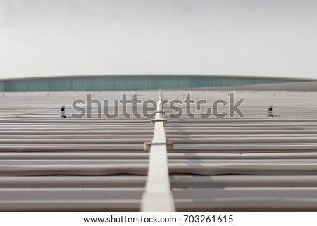 Aluminium Lightning Conductor On The Metal Roof In A Cloudy Day
