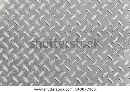 Aluminium metal silver list with rhombus shapes. - stock photo