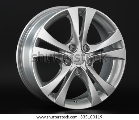 Aluminium metal wheel rim texture. Car alloy wheel, isolated on black background
