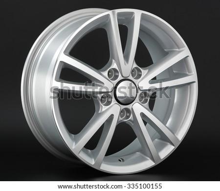 Aluminium metal wheel rim texture. Car alloy wheel, isolated on black background - stock photo
