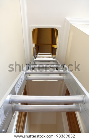 Aluminium step ladder into loft or attic space - stock photo