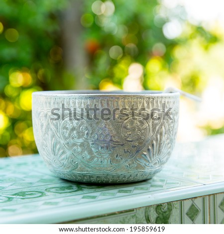 Aluminium water bowl - stock photo