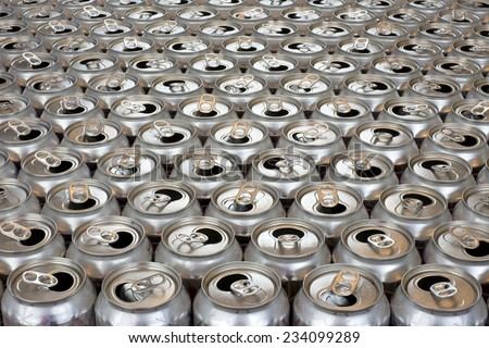aluminum can recycling close up view tops of empty cans horizontal view - stock photo