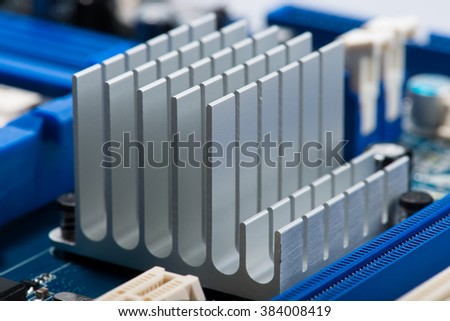 Aluminum cpu cooler heat sink isolated on white - stock photo