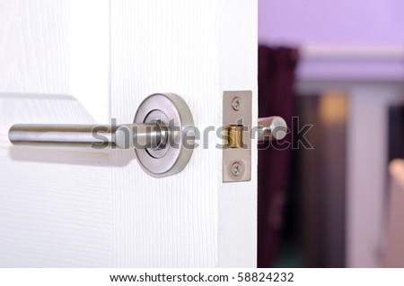 Aluminum doors knob. - stock photo