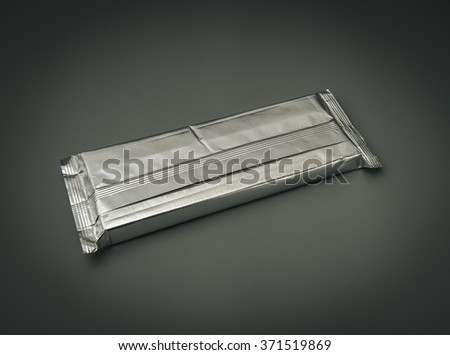 Aluminum foil package.  - stock photo