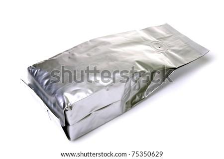 Aluminum foil package isolates on white background. - stock photo