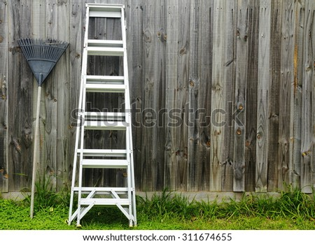 Aluminum ladder against the wall. - stock photo