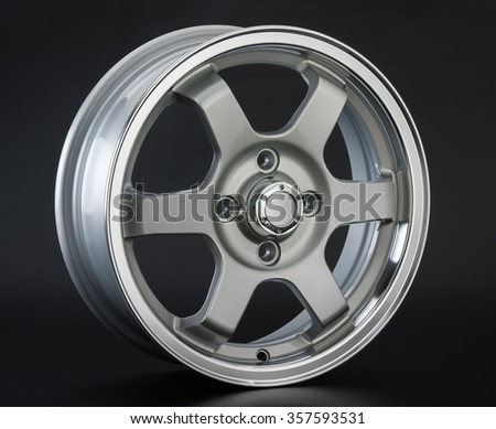 Aluminum metal wheel rim texture. Car alloy wheel, isolated on black background