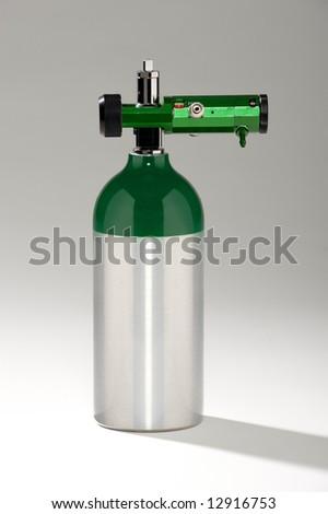 Aluminum oxygen tank with regulator - stock photo