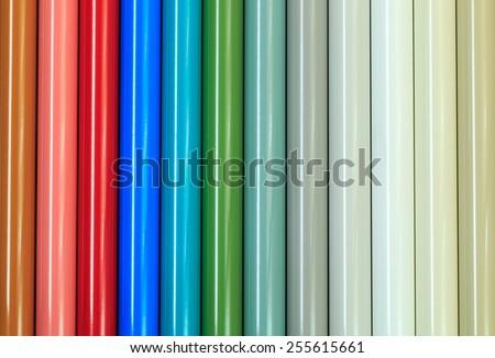 Aluminum profiles coated with powder coating on wooden background - stock photo