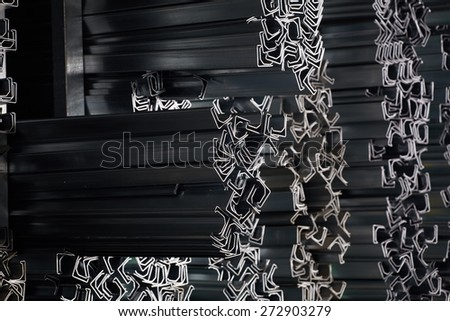 Aluminum profiles. Industrial background - stock photo