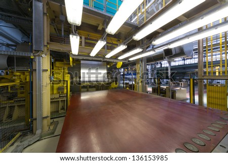 Aluminum rotates on machine in workshop on rolling mill - stock photo