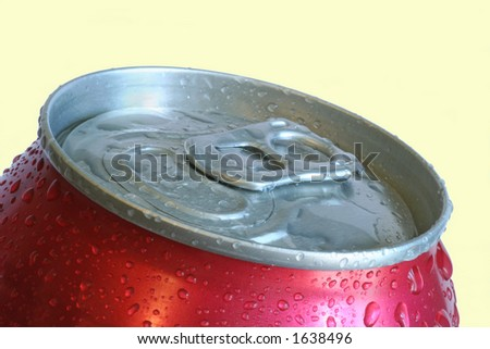 aluminum soft drink can with water droplets close up over yellow - stock photo