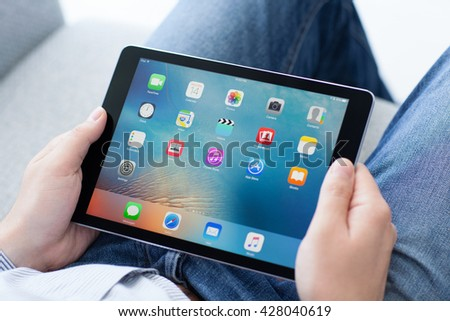 Alushta, Russia - May 14, 2016: Man holding in the hand a new iPad Pro Space Gray. iPad Pro was created and developed by the Apple inc. - stock photo