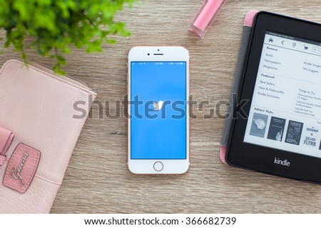 Alushta, Russia - November 5, 2015: iPhone 6S Rose Gold with social networking service Twitter on the screen in the table. iPhone 6S was created and developed by the Apple inc. - stock photo