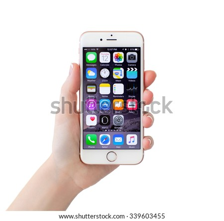 Alushta, Russia - November 12, 2015: Isolated woman hand holding iPhone6S Rose Gold. iPhone 6S Rose Gold was created and developed by the Apple inc. - stock photo