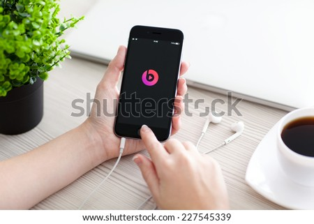 Alushta, Russia - October 24, 2014: Girl holding a iPhone 6 Space Gray with service Beats Music on the screen. iPhone 6 was created and developed by the Apple inc. - stock photo