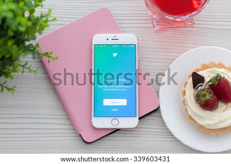 Alushta, Russia - October 25, 2015: iPhone6S Rose Gold with app Twitter on the table. iPhone 6S Rose Gold was created and developed by the Apple inc. - stock photo
