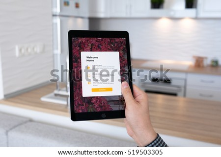 Alushta, Russia - October 29, 2016: Man hand holding iPad Pro Space Gray with app Home in the screen. iPad Pro 9.7 was created and developed by the Apple inc.