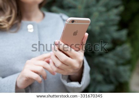 Alushta, Russia - October 24, 2015: Woman holding in the hand a new iPhone 6 S Rose Gold. iPhone 6S was created and developed by the Apple inc. - stock photo