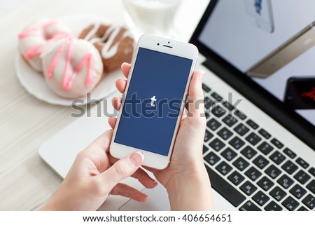 Alushta, Russia - October 29, 2015: Woman holding iPhone6S Rose Gold with social networking service Tumblr on the screen. iPhone 6S Rose Gold was created and developed by the Apple inc. - stock photo