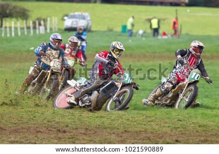 ALVELEY, UK - OCTOBER 1: A group of solo riders competing in the spring grasstrack Bewdley MCC meeting head into the apex of a corner at speed on October 1, 2017 in Alveley