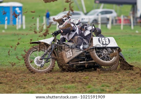 ALVELEY, UK - OCTOBER 1: A sidecar team competing in the spring grasstrack Bewdley MCC meeting lift the chariot off the ground as they negotiate the apex of a corner on October 1, 2017 in Alveley