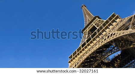 Always awesome... the Eiffel Tower against a radiant blue sky - stock photo