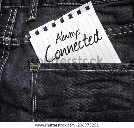 Always Connected written on a peace of paper on a jeans background  - stock photo