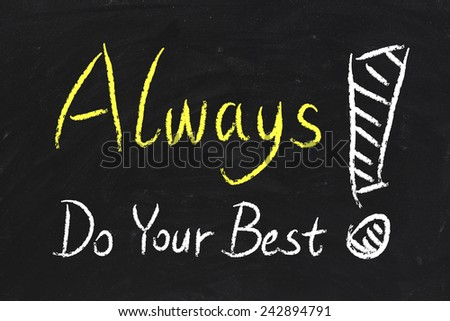 Always Do Your Best text is written by chalk on blackboard. - stock photo
