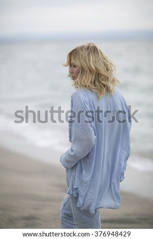 """always forward. The ease of mind. Woman enjoying the sea breeze , sea and sand . Smiles , do not think of """"tomorrow"""" . - stock photo"""