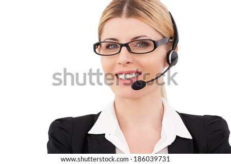 Always ready to help you. Confident mature customer service representative in headset looking at camera and smiling while standing isolated on white - stock photo