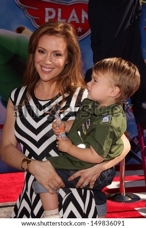 Alyssa Milano with her child at the World Premiere Of Disney's Planes, El Capitan, Hollywood, CA 08-05-13 - stock photo
