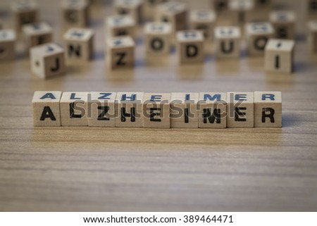 Alzheimer (German Alzheimer's) written in wooden cubes on a table
