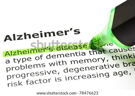 Alzheimer's disease highlighted in green, under the heading Alzheimer's. - stock photo
