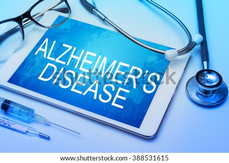 Alzheimers Disease word on tablet screen with medical equipment on background - stock photo