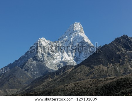 Ama Dablam (6812 m) in the first light of the Sun (view from Tengboche monastery) - Everest region, Nepal, Himalayas - stock photo