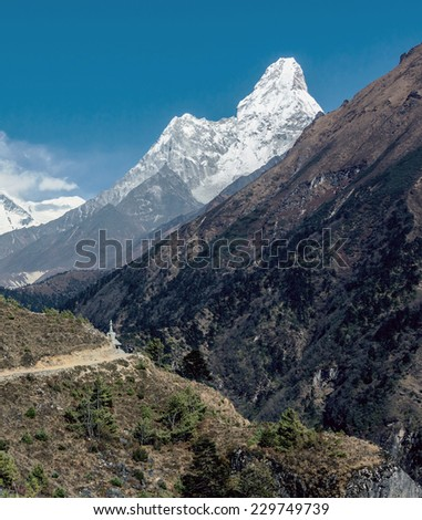 Ama Dablam (6814 m). View from the trek to Namche Bazar - Nepal, Himalayas - stock photo