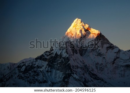 Ama Dablam peak at sunset. - stock photo