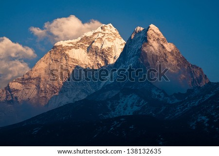 Ama Dablam peak (6814 m) at sunset. Himalayas. Nepal - stock photo