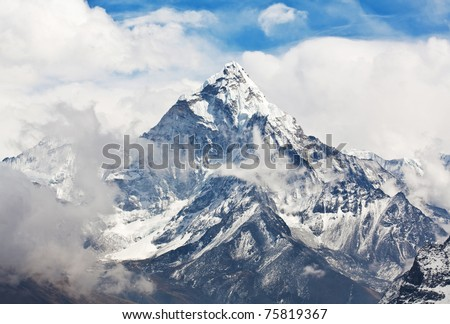 Ama Dablam peak - view from Cho La pass, Sagarmatha National park, Everest region, Eastern Nepal. Ama Dablam (6858 m) is one of the most spectacular mountains in the world and a true alpinists dream. - stock photo