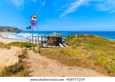 AMADO BEACH, PORTUGAL - MAY 15, 2015: surfing school kiosk on Praia do Amado beach in spring, Algarve region, Portugal. This area is famous surfing place in whole Portugal. - stock photo