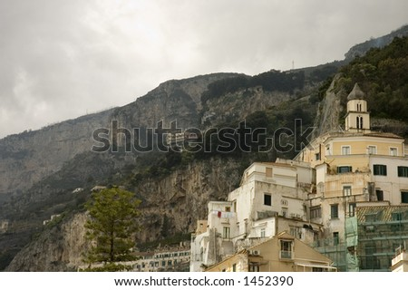 Amalfi cityscape with houses and church built on the mountain slope,  Italy