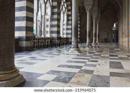 Amalfi, Italy, August 11, 2014: Amalfi Cathedral  (it.Duomo di Amalfi), external colonnade. The church is dedicated to Apostle Saint Andrew. Predominantly of Arab-Norman Romanesque architectural style - stock photo
